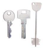 在白色的三把钢钥匙 库存图片