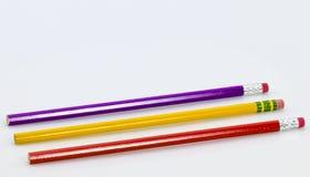 在白色的三支木锋利的铅笔 库存照片