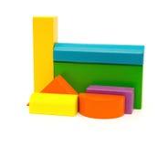 在白色的不同的颜色和形状木玩具块 库存照片