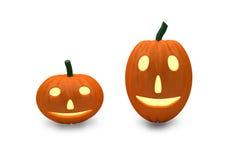 在白色的两个微笑的南瓜 免版税库存图片