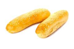 在白色的两个热狗小圆面包 库存照片