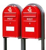 在白色的两个红色邮政专用信箱 免版税库存图片
