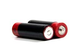 在白色的两个AA电池与剪报 库存照片