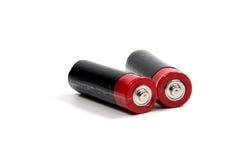 在白色的两个AA电池与剪报 免版税库存图片