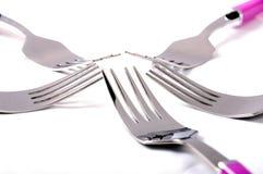 在白色的五把叉子 库存图片