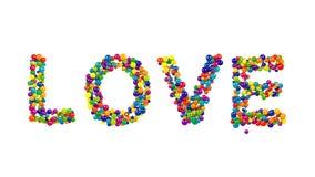 从在白色的五颜六色的球形成的爱 库存照片