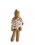 绳索在白色的伏都教玩偶 免版税库存照片