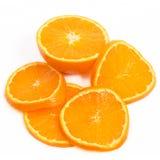 在白色的切的桔子 图库摄影