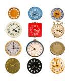 在白色的古色古香的五颜六色的钟盘收藏 免版税库存图片