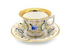 在白色的古色古香的biedermeier时间咖啡杯隔绝了背景 免版税库存图片