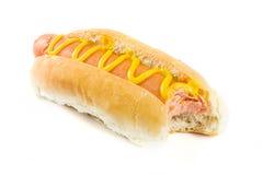 在白色的叮咬狗热缺少芥末 库存图片