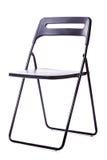 在白色的可折叠的椅子 免版税库存图片