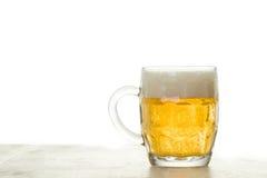 在白色的啤酒 免版税图库摄影