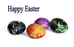 在白色的四个美丽的复活节彩蛋 图库摄影