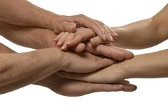 在白色的团结的手 免版税库存图片