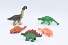 在白色的塑料恐龙玩具 图库摄影