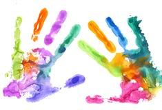 在白色的多彩多姿的手印刷品 库存图片