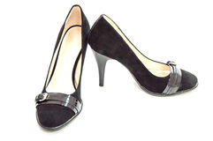 在白色的妇女媒介被停顿的法院鞋子 库存照片