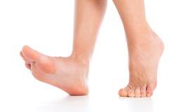 在白色的妇女脚 免版税图库摄影