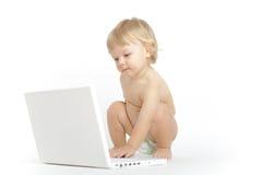 在白色的婴孩膝上型计算机 库存照片