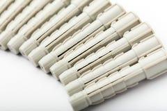 在白色的定缝销钉 免版税库存照片