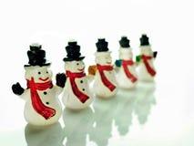 在白色的小雪人 免版税库存照片