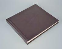 在白色的小黑象册 免版税库存图片