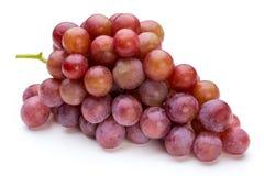 在白色的成熟红葡萄 免版税库存图片