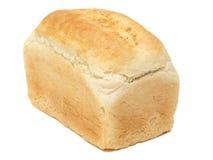 在白色的接近的有壳的大面包上添面&# 免版税库存照片