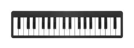 在白色的数字式钢琴 免版税库存图片