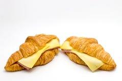 在白色的新月形面包面包 免版税库存图片