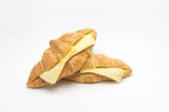 在白色的新月形面包面包 库存照片