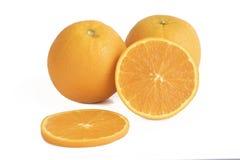 在白色的新鲜的黄色桔子 免版税库存照片