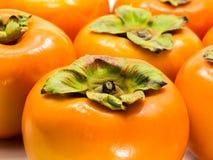 在白色的柿子 库存图片
