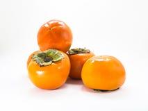 在白色的柿子 免版税库存照片