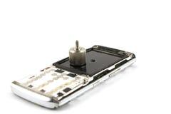 在白色的残破的移动电话 库存图片