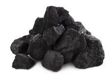 在白色的煤炭堆 免版税库存图片