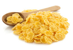 在白色的玉米片 免版税库存照片