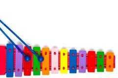 在白色的玩具木琴 免版税库存图片