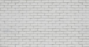 在白色的砖墙 图库摄影