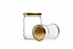 在白色的空的玻璃瓶子 库存照片