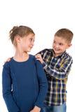 在白色的笑的小孩子 免版税库存照片
