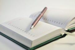 在白色的笔记本 免版税库存图片