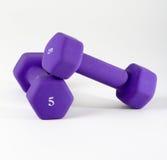 在白色的紫色dumbells 图库摄影