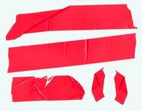在白色的红色包装磁带 免版税库存图片