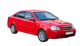 在白色的红色汽车。 查出在白色 库存照片