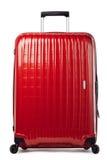 在白色的红色碳手提箱 库存图片