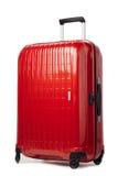 在白色的红色碳手提箱 免版税库存图片
