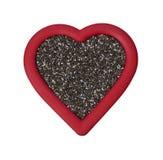 在白色的红色Chia种子心脏 免版税库存照片