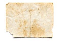 在白色的老被弄脏的和被撕毁的纸 免版税库存图片